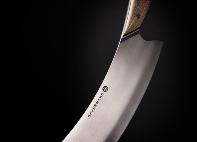 Curved blade on the cheese knife
